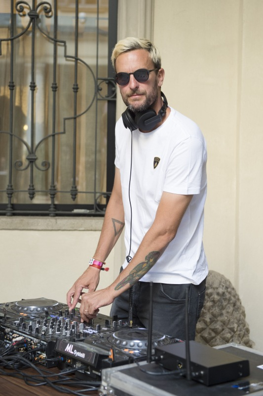 MILAN, ITALY - JUNE 16: Dj Mazai performs at Collezione Automobili Lamborghini SS 19 Presentation at Milan Men's Fashion Week 2018 on June 16, 2018 in Milan, Italy. (Photo by Stefania M. D'Alessandro/Getty Images for Lamborghini) *** Local Caption *** Dj Mazai